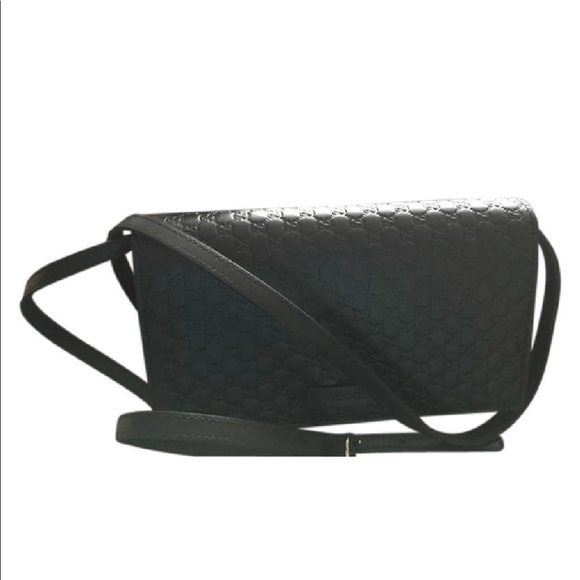1e062454a3df Gucci Handbags - Gucci black microguccissima cross body bag